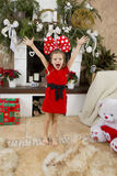 Little girl in a red dress with a large bow Stock Photography