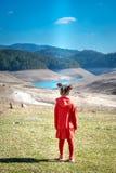 Little girl in red dress Stock Image