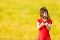 Little girl in a red dress Stock Photography