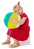 Little girl in a red dress with polka dots Royalty Free Stock Image
