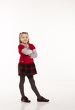 Little girl in red dress posing standing in studio Stock Photography