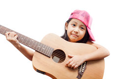 Little girl red dress standing with guitar. Stock Image