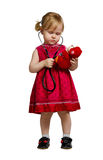 Little girl in a red dress Stock Image