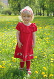 Little girl in a red dress for a walk Stock Photo