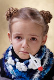 Little girl with red eyes having the flu Stock Photos