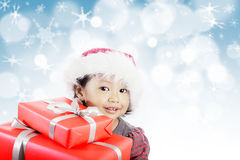 Little girl with red gifts Royalty Free Stock Photos