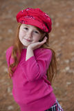 Little girl with red hair in hat Royalty Free Stock Photo
