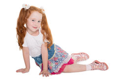 Little girl with red hair sitting Stock Photos