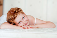 Little girl with red hair in a white dress Royalty Free Stock Image