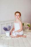 Little girl with red hair in a white dress Royalty Free Stock Photography