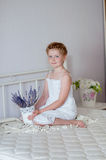 Little girl with red hair in a white dress  Royalty Free Stock Images
