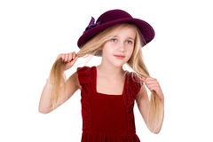 Little girl in a red hat Stock Image