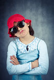 Little girl in red hat and sunglasses disappointed Royalty Free Stock Photography