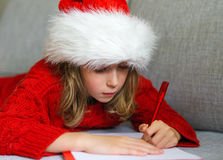 Little girl in red hat. Stock Photos