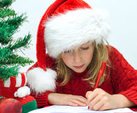 Little girl in red hat. Royalty Free Stock Images