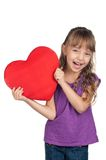 Little girl with red heart Stock Images