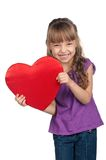 Little girl with red heart Royalty Free Stock Images