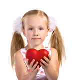 Little girl with red heart Royalty Free Stock Photos