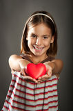 Little girl with red heart Royalty Free Stock Image
