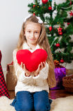 Little girl with red heart toy Stock Photos