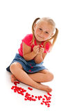 Little girl with red hearts Stock Photo