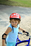 Little girl in a red helmet Stock Photography