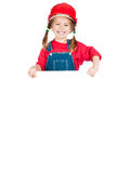 Little girl in red helmet. Smiling Little girl in a red helmet with white board isolated on a over white Royalty Free Stock Photo