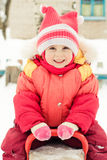 Little girl in a red jacket Royalty Free Stock Images