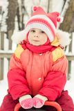 Little girl in a red jacket Royalty Free Stock Photo