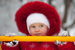 Little girl in a red jumpsuit Stock Photos