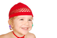 Little girl with red knitted hat Royalty Free Stock Image