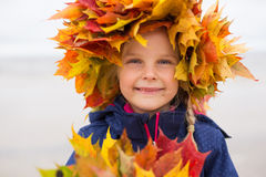Little girl with red leaves around her head Royalty Free Stock Photos