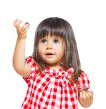 Little girl in red making funny face. Stock Photo