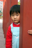 little Girl in red pillars Royalty Free Stock Images