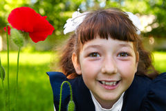 Little girl and a red poppy Royalty Free Stock Image