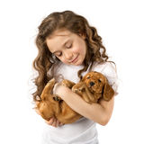Little girl with red puppy isolated on white background. Kid Pet Friendship Stock Photos