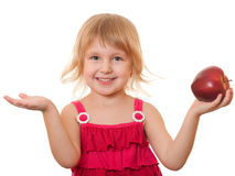 Little girl in red with red apple Stock Image