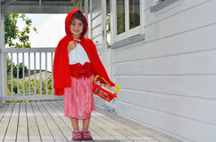 Little girl with Red Riding Hood costume Stock Photos