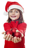 Little girl with a red santa cap Stock Photo