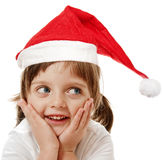 Little girl with red santa cap Royalty Free Stock Image