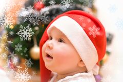 Little girl in red Santa hat Stock Photo