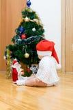 Little girl in red Santa hat Stock Photos