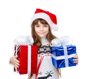 Little girl in red santa hat and gift boxes. isolated on white Stock Photos