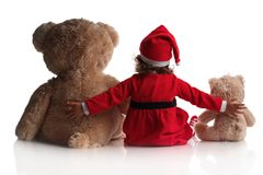 Little girl in red santa hat holds teddy bear toys on white background. Little girl in red santa hat and teddy bear toys  on white background Royalty Free Stock Photos