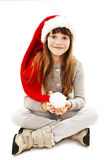 Little girl in red Santa hat Royalty Free Stock Images