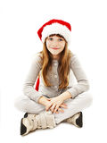 Little girl in red Santa hat. Isolated on white background stock images