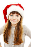 Little girl in red Santa hat Stock Photography