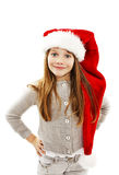 Little girl in red Santa hat. Portrait. Isolated on white background royalty free stock image