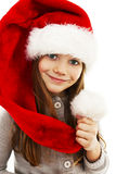 Little girl in red Santa hat. Portrait. Isolated on white background royalty free stock photos