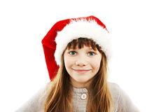 Little girl in red Santa hat. Portrait. Isolated on white background stock photo